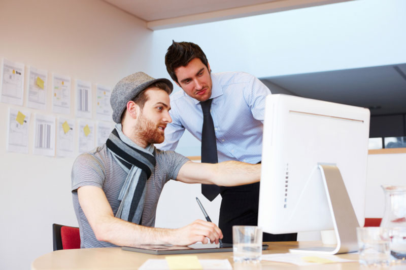 man-with-colleague-point-at-screen--buyer_personas,_web_design