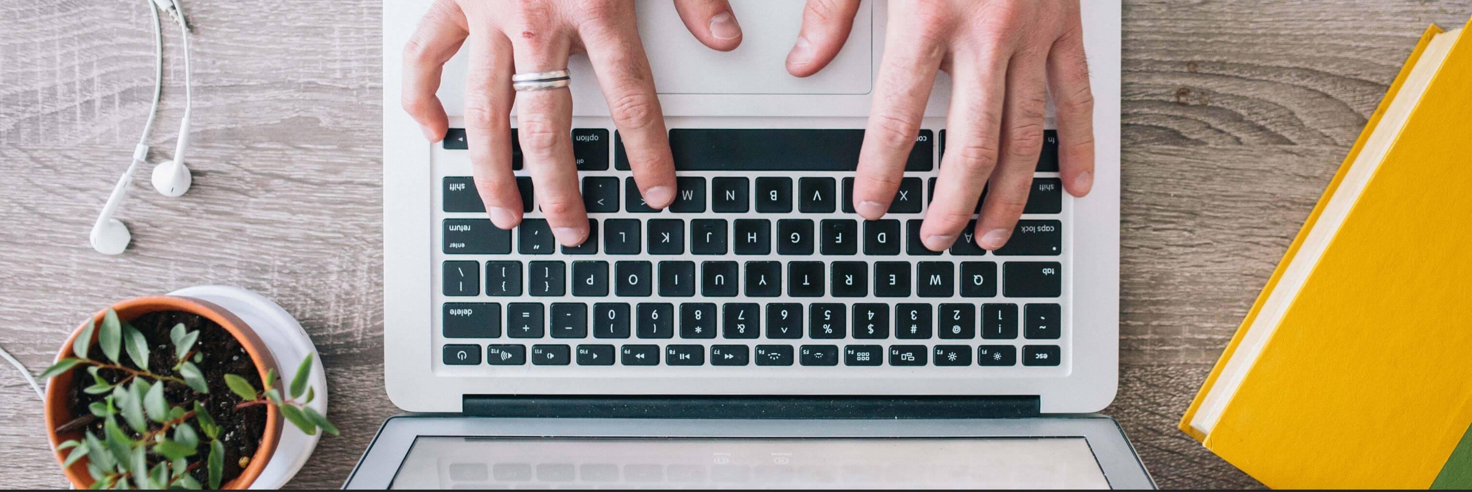 SaaS Marketing hero image of laptop keyboard 1200 x 400.jpg
